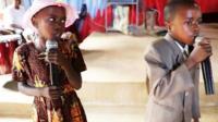 Ubang boy and girl singing