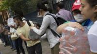 People help distribute supplies
