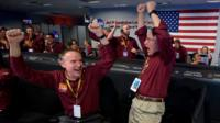 Mars InSight team members Kris Bruvold (L) and Sandy Krasner react after receiving confirmation that the Mars InSight lander successfully touched down