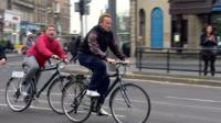 Arnold Schwarzeneggar cycling in Edinburgh