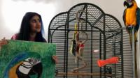 Kitty Kaur with an image of her parrot Rio