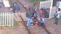 People taking pictures on a train track
