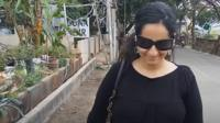 Poonam walking on a street in Bangalore