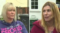 Two women talking about bins in Conwy
