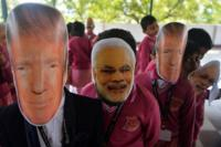 People wearing Trump and Modi masks in India