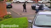 Armed raiders outside house