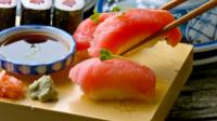 Salmon sushi on a wooden board