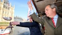 Nigel Farage throwing fish into the Thames