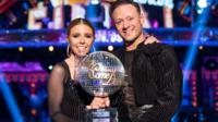 Stacey Dooley and Kevin Clifton with the Strictly Come Dancing Glitterball trophy