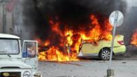 Destroyed car after a car bombing in Syria