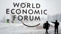 A security guard show the way outside the congress centre ahead of the World Economic Forum (WEF) 2018 meeting in Davos