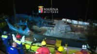 Timelapse footage of Italian navy raising boat from bottom of Mediterranean