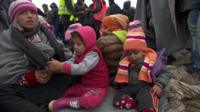 Family waits in the mud to enter Croatia