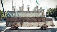 """Battle Bus"" a sculpture of a bus with oil drums by Nigerian artist Sokari Douglas Camp"