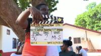 Man with clapperboard