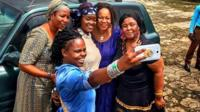 Katchie Nzama poses for a selfie on her travels