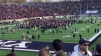 Protesters on the football pitch of a Harvard-Yale game