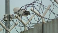 Barbed-wire wall surrounds a registration centre in Zagreb