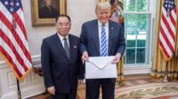 Trump holding letter