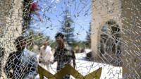 Bullet hole in a hotel window in Sousse