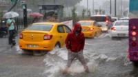Man standing in flood water in Istanbul