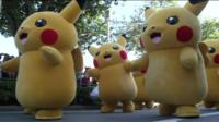Pikachus walking at a festival .