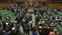 MPs leave the chamber to vote on an amendment