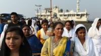 Indian women leave after visiting the shrine