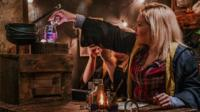 Woman mixing potions