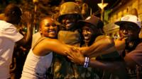 People celebrate the arrival of the regional ECOWAS force in Banjul, Gambia 22 January, 2017.