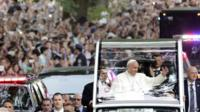 Pope Francis waves to crowds in Central Park in New York