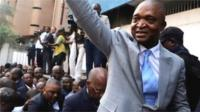 """Former Congolese interior minister Emmanuel Ramazani Shadary waves to his supporters as he arrives to file his candidacy for the presidential election, at the Congo""""s electoral commission (CENI) head offices at the Gombe Municipality in Kinshasa, Democratic Republic of Congo, August 8, 2018."""