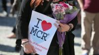 "A woman holds an ""I heart MCR"" sign."