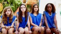School girls in football kit