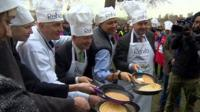 MPs in chef hats with pancakes in pans
