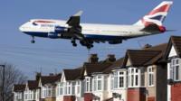 Plane flies over houses near Heathrow airport