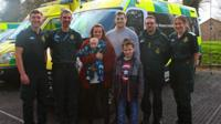 The couple and their children and paramedics