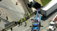 Aerial view of truck dangling from bridge in Michigan