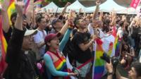 Crowds celebrate in Taiwan as the parliament becomes the first in Asia to pass a same-sex marriage law