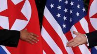 Kim Jong-un and Donald Trump handshake