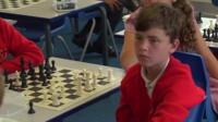 Children from Sacred Heart school concentrate in their chess lessons