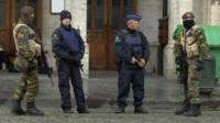 Armed soldiers guard the Grand Place