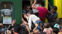 Migrants board trains in Keleti station, Budapest