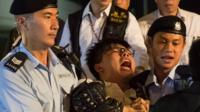 Demosisto secretary general Joshua Wong is arrested by police after climbing on the Golden Bauhinia statue during a protest in Golden Bauhinia Square in Hong Kong, China, 28 June 2017