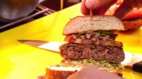 Chef shows off a burger