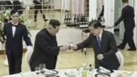 Kim Jong-un and a South Korean official raise a toast over dinner