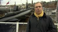 Peter Hitchens at a dockyard