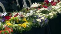 Flowers laid at memorial service
