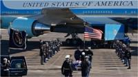 The 41st president's body is being flown from Texas to Washington on board Air Force One.