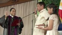 Rodrigo Duterte (centre) is sworn in as president of the Philippines